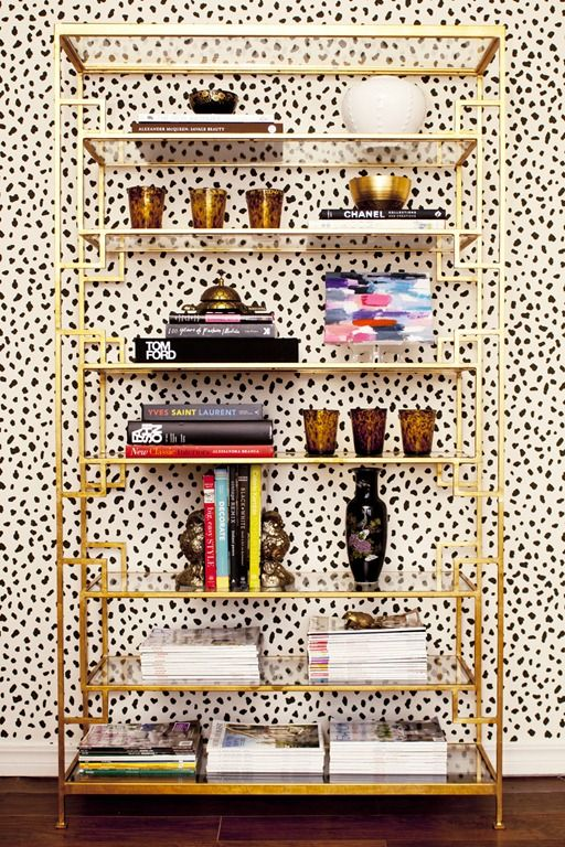 Brass etagere + dotted walls