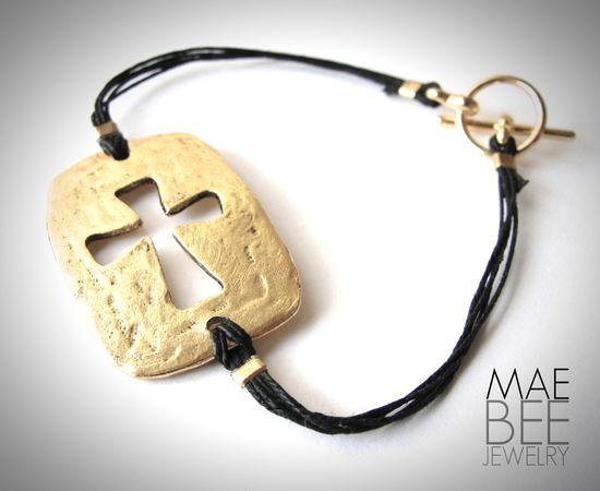 Gold Pewter Sideways Cut-Out #Cross #bracelet on black linen from JewelryByMaeBee on #Etsy.