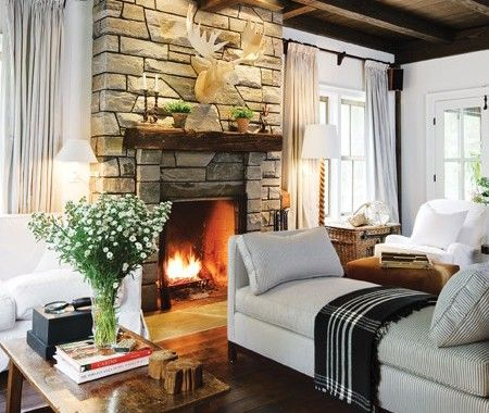 grey stone fireplace in living room
