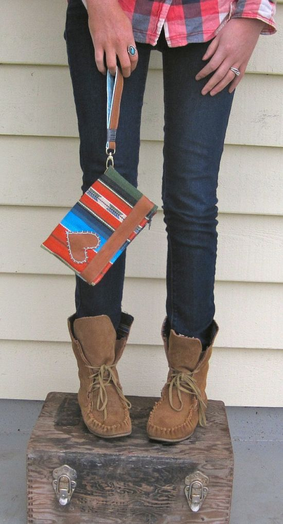 cute jeans, boots, top, and hand made clutch purse