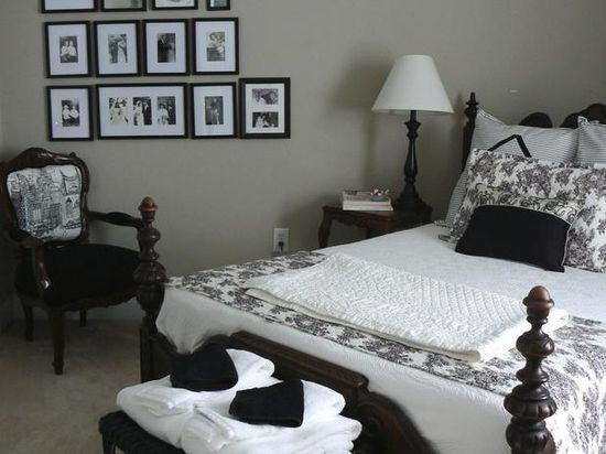 Gray wall color with black-and-white decor. Gorgeous! www.hgtv.com/...