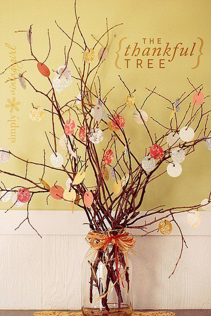 Have your guests write what they're thankful for on small leaf shaped pieces of paper, then hang them to a twig arrangement centerpiece.