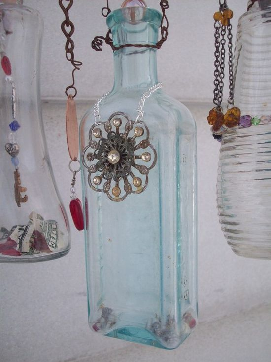 Bottle Chime Mobile: Vintage bottles embellished with found objects, buttons beads, etc. #crafts #bottles #glass #vintage #embellish #DIY