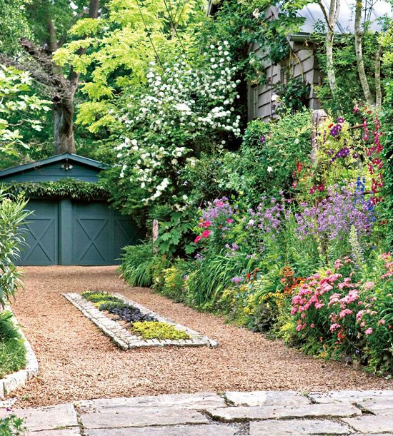 Flower bed and gravel driveway...