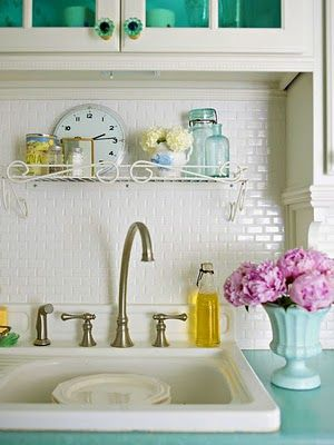 mini subway tiles for kitchen backsplash? hmmmm  Love the counter top color and the glass color of the cabinet knobs and glass, ect...