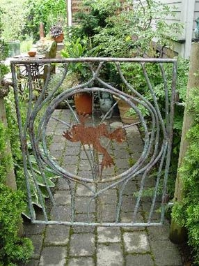 Garden gate with frog
