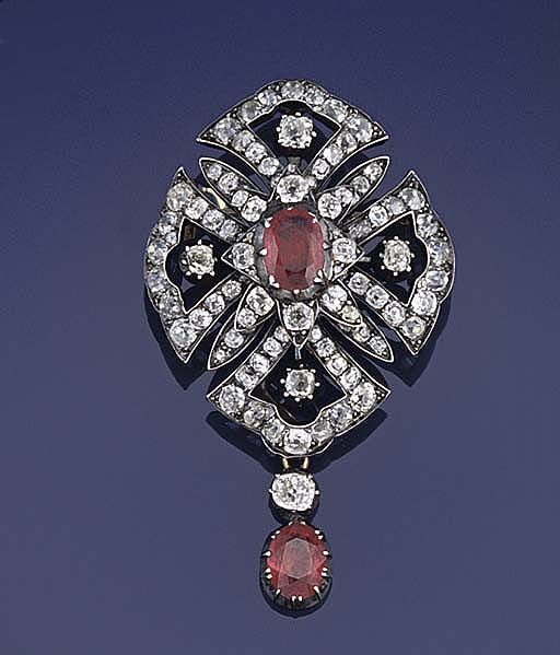 A late 19th century ruby and diamond brooch  The openwork quatrefoil panel set throughout with old-cut diamonds to a star cluster centre with single oval ruby, suspending a ruby drop with old-brilliant-cut diamond surmount, circa 1890