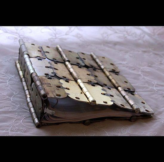 Hinged scrapbook.