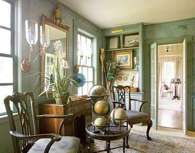 Pale green walls, gold accents, antiques, sconces