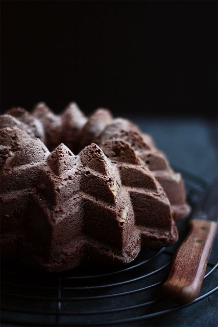Dark chocolate cake baked in a sunflower bundt pan with a dusting of cocoa and vanilla sugar. on Sneh Roy flickr...check her blog at Cook Republic