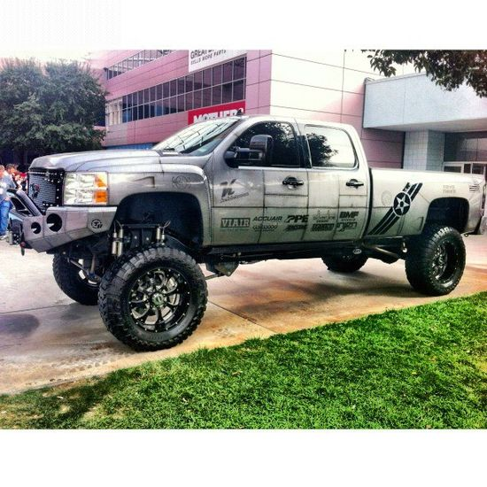 """straight axle Chevy sporting 10-12"""" lift kit"""