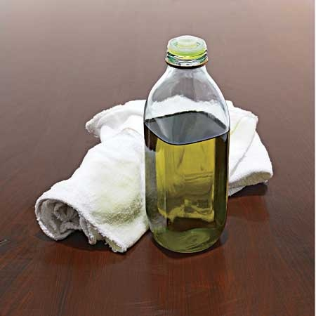 Olive oil brightens up wood. Use a thin coat to hydrate worn, dried-out wood, as long as it was origin ally treated with an oil finish. Finish by buffing it in.