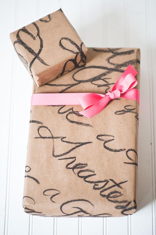 Super easy, hand written butcher paper with hairspray to use as wrapping paper. wrapping paper, wrapping, gift wrapping idea, paper, wrapping paper, wrapping present, craft, diy