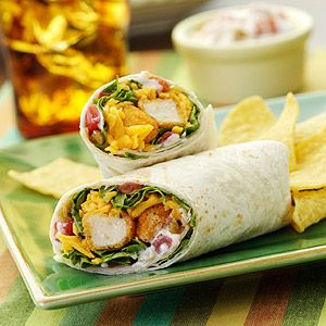 Crisp chicken tenders topped with spicy sauce, shredded lettuce, and cheese wrapped in warm tortillas.