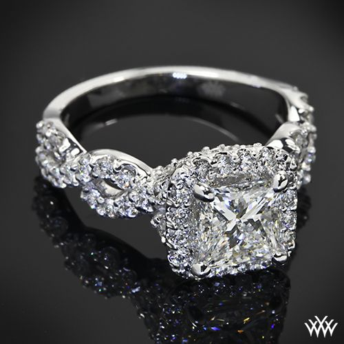 LOVE! just not..quite..this big :) Custom Diamond Engagement Ring is set in 14k white gold and features a twisted shank and cushion shaped halo that shines with 0.70ctw A CUT ABOVE® Hearts and Arrows Diamond Melee. The 4 delicate prongs hold a dazzling 1.30ct Princess Cut Diamond. AMAZING