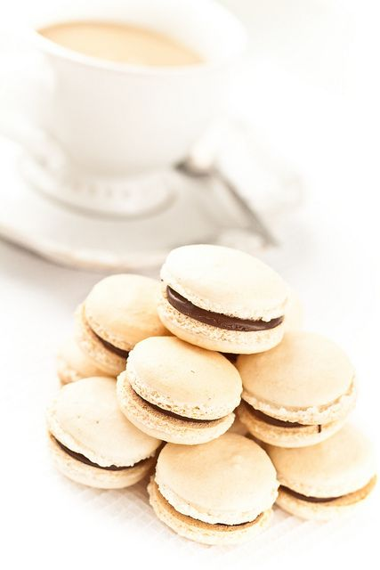 . . coconut macarons with nutella . .