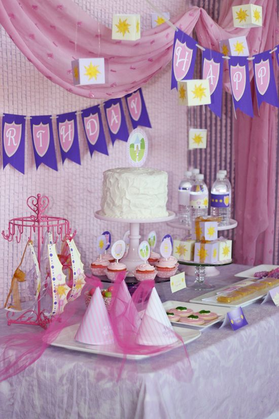 Sweet Rapunzel theme party @Ashley O'Flaherty.  My fav part is the yellow twizzlers as Rapunzel's braids:)