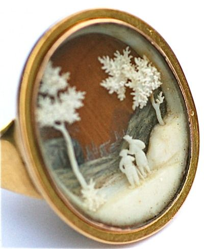 Georgian micro-ivory ring: A high carat gold ring, circa 1780, the tapered hoop terminating in a compartment containing a multi-dimensional micro-ivory scene, set under crystal.