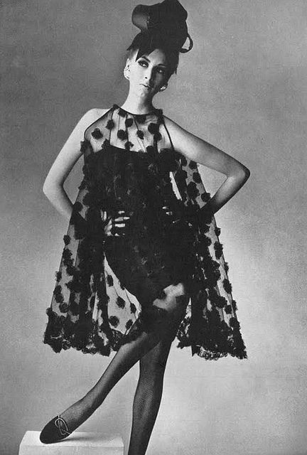 Wilhelmina Cooper is wearing a dress by Townley and Roger Vivier shoes. Photo by Penn. UK Vogue, March 1965.