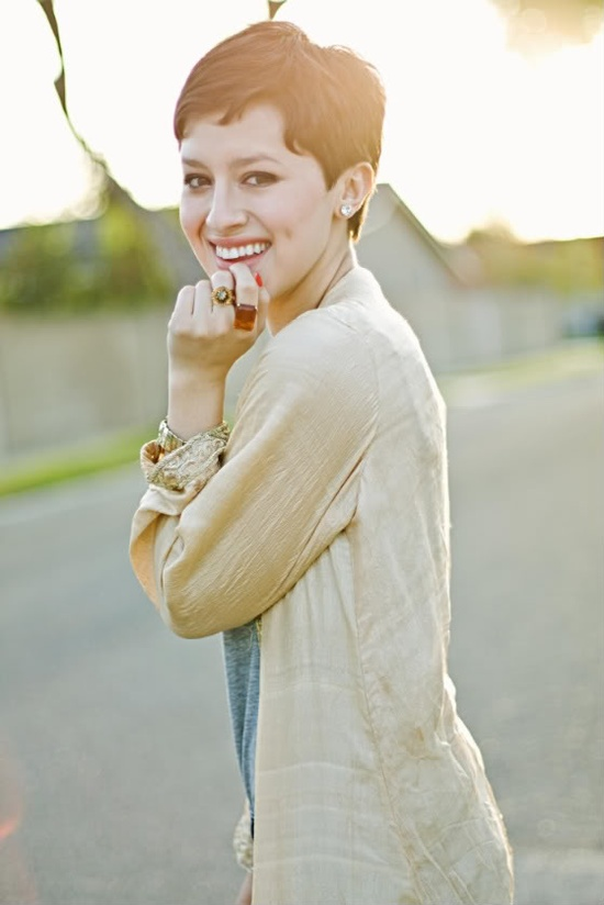 Cute pixie cut -- if I didn't have naturally curly hair, I'd do this cut someday! But mine would just stick up all over!