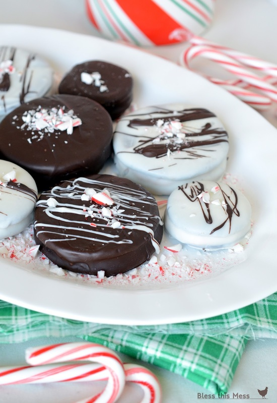 Double Dark Candy Cane Crunch Cookies - homemade oreos, candy cane filling, dipped in chocolate. Oh yeah!