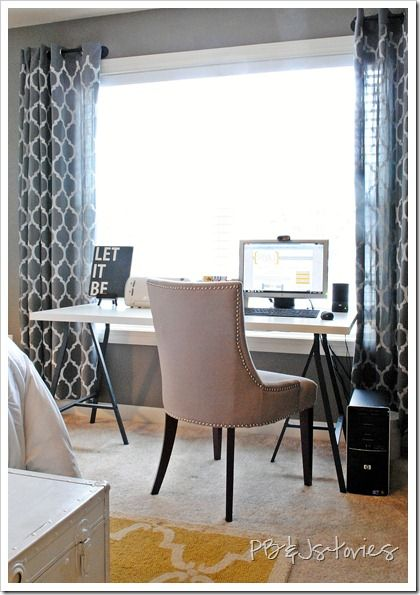 If when we move we HAVE to have our office space in the bedroom... I hope we can make it look something like this ? I also love her solution for having no drawers in the desk itself.