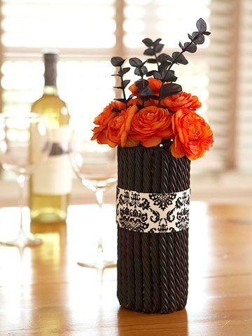 Flower arrangements take a dark & sweetly sinister turn when arranged in a vase (potato chip can) adorned with black licorice. BH red for Valentines