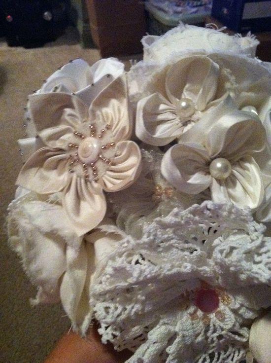 Handmade fabric flowers in wedding bouquet