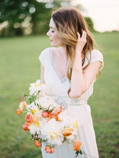 a white bouquet with pops of tangerine Photography by Ryan Ray Photography / ryanrayphoto.com, Floral Design by Bows and Arrows / bowsandarrowsflowers.com/