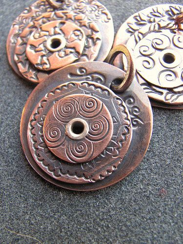 Riveted Copper Swirl Pendant~love this! Use inexpensive washers!!!