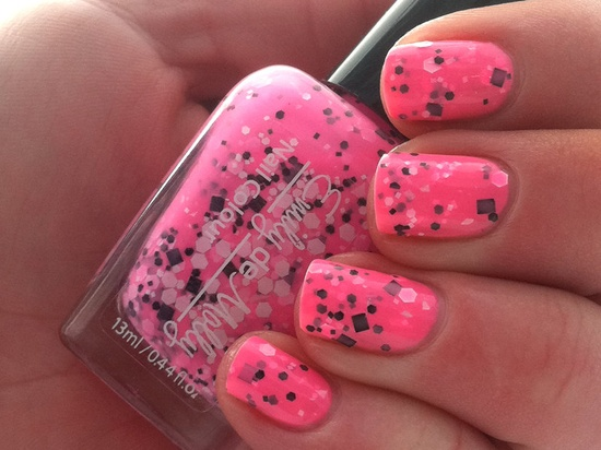"Nail polish - ""Flurocious"" black and white glitter in a neon pink base. $10.00, via Etsy."