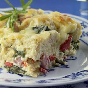 This healthy update of a traditionally rich ham-and-cheese breakfast strata is made lighter primarily by losing a few egg yolks and using nonfat milk. Gruyere cheese has a delicious, nutty aroma and flavor, which means that with the relatively small amount in this recipe you still get a big impact. To finish the makeover use nutritious, fiber-rich, whole-grain bread instead of white. The results: plenty of flavor, half the calories and one-third the fat of the original.