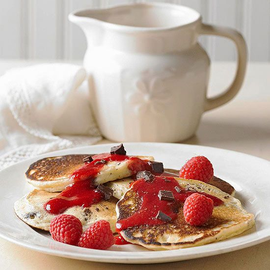 Try these Chocolate Chip Pancakes with Raspberry Sauce for a delectable breakfast! More pancake recipes: www.bhg.com/...