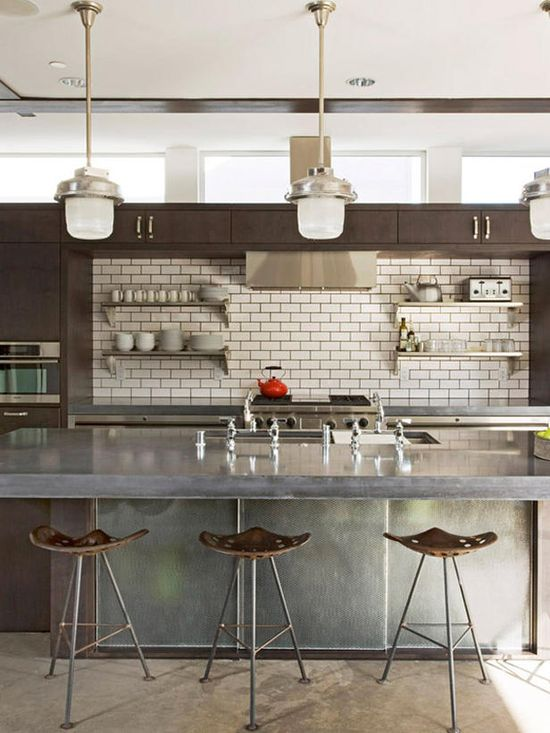Weinstein neutral #kitchen 3.  This industrial modern kitchen features everything a home chef would ever want. Custom wood cabinetry is combined with white subway-style tiles, while vintage finds like tractor seat stools and industrial hanging lights help to create an eclectic mix of old and new.