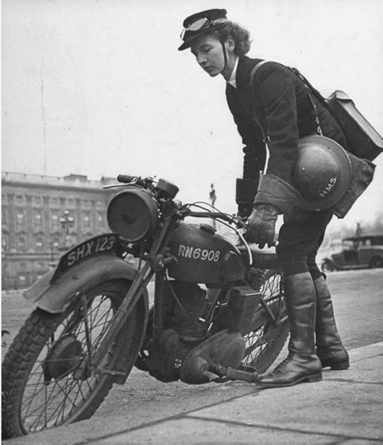 girl getting on a motorcycle