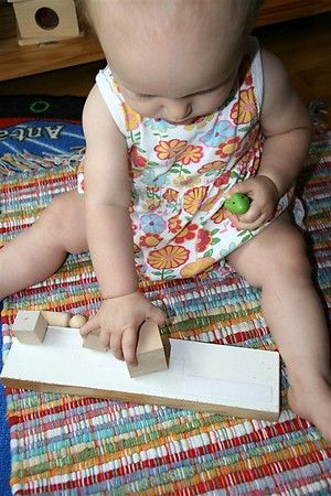 15 Independent Activities for One Year Olds. Velcro boards, texture books, buckle clipping, & treasure baskets.