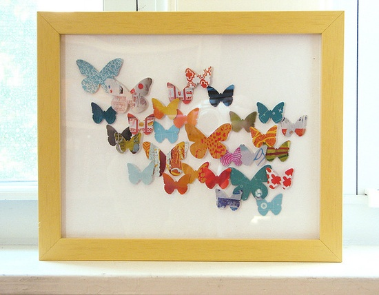 punched paper butterfly collage - it's the varying sizes and paper patterns as well as the layout that make this so interesting