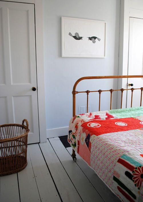iron bed, bright quilt