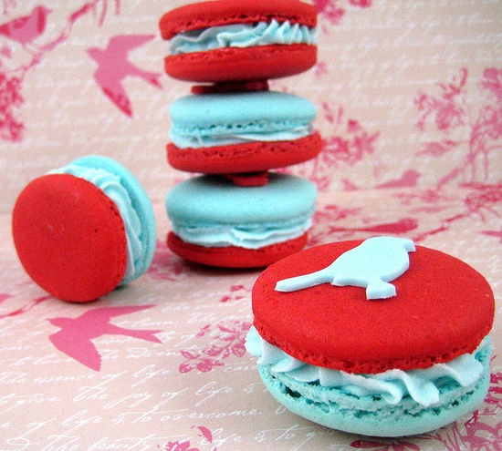 Wonderfully eye-catching red and aqua hued bird adorned macarons. #red #aqua #bird #macarons #food #cooking #baking #cookies #dessert #French #pastry