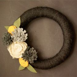 Yarn wrapped wreath with felt and burlap flowers.  Perfect splash of color for Spring.