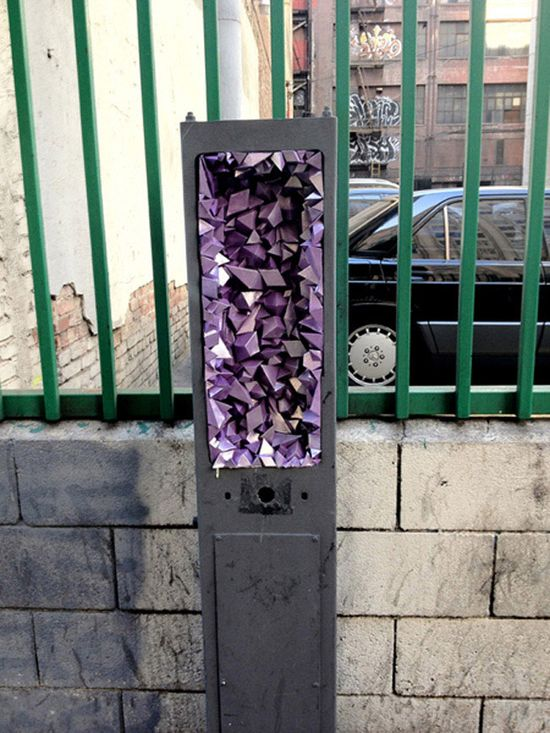 """""""Geode"""" Project. Designer and artist A Common Name creates 3D paper sculptures in the holes of buildings and random pipes around the Los Angeles area"""
