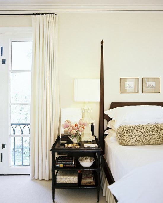 Beautiful serene bedroom in cream and charcoal. I love the little prints above the bed and beautiful styling of the nightstand.
