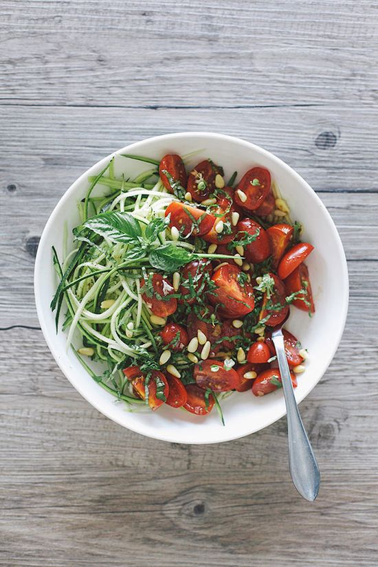 Zucchini noodles with basil and marinated tomatoes.