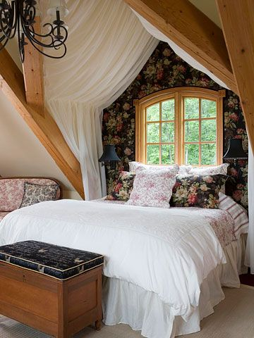 Romantic Bedroom. I just LOVE this room! Exposed beams frame this master bedroom in romance. Sheer fabric hangs from the vaulted ceiling, creating a gauzy tent over the bed. The wall behind the bed becomes the headboard when upholstered with batting and fabric. The burgundy toile coverlet and accent pillow add an additional layer of comfort and style. I'd change flowers to dark blue