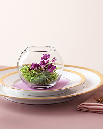 "Encased in inexpensive vessels, miniature violets take on a delightful ""Alice in Wonderland"" appeal. To assemble them, put the flowers in glass bowls, add a few pieces of plant charcoal at the roots (this will help them thrive), and press in fresh moss to conceal."