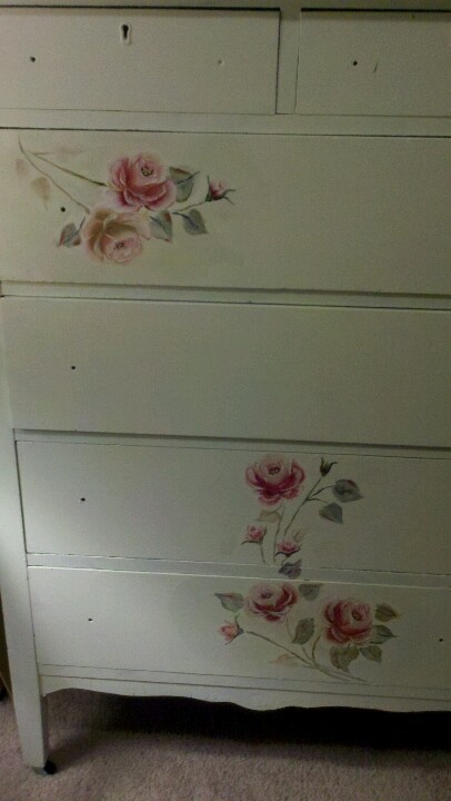 I painted vintage style roses on a old family dresser...