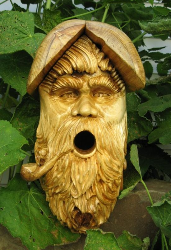 wonderful hand carved birdhouse