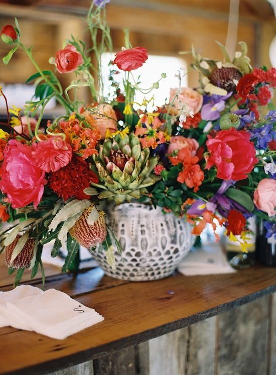 An eclectic mix of florals for a centerpiece makes for a very interesting and intriguing arrangement.