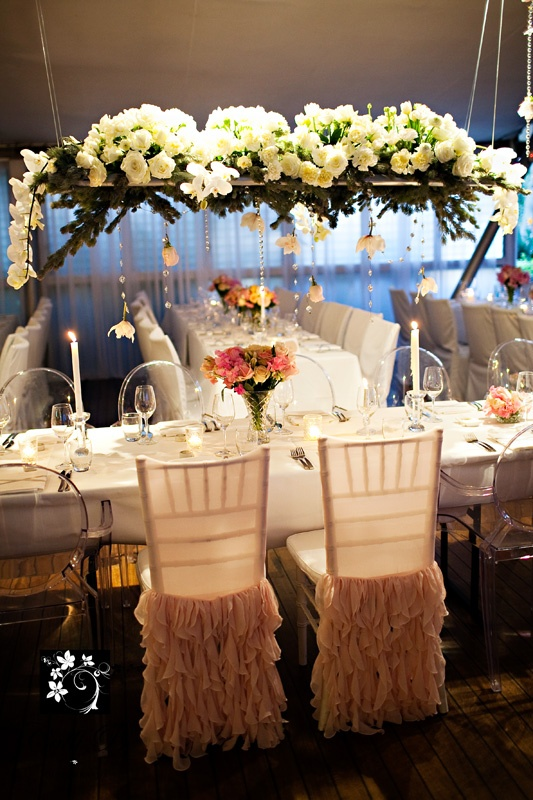 Love the hanging flowers head table centerpiece