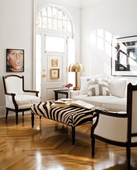 Black white gray gold living room, chevron floors, zebra ottoman, brass mushroom lamp, contemporary photography